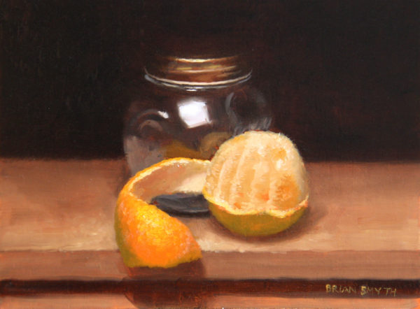 Peeled orange and jar